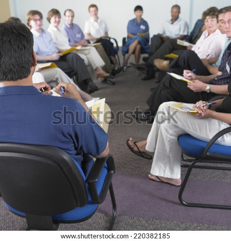 Business people in conference - stock photo