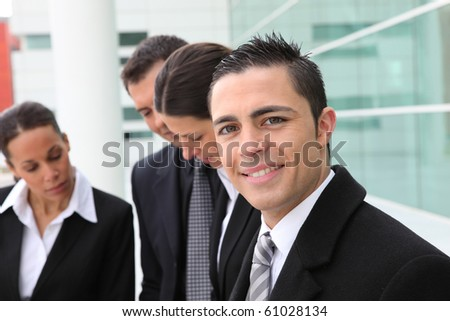 Business people in front of an agency