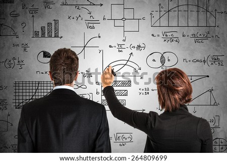 Business people in front of math formulas - stock photo