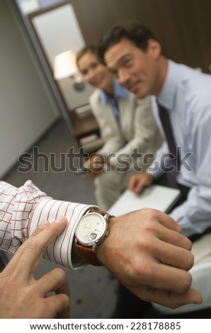 Business people in hotel room - stock photo