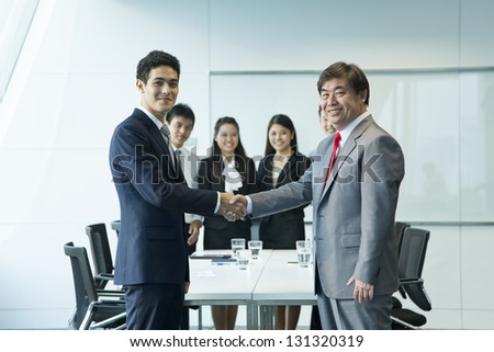 Business people in meeting room. - stock photo