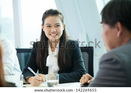 Business people in meeting room - stock photo