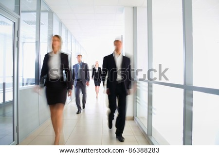 Business people in modern office - stock photo