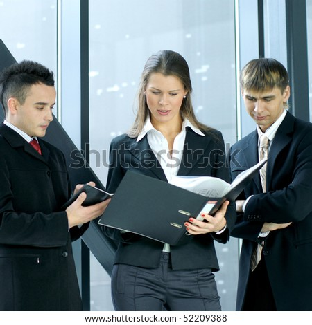 Business people in modern office interior - stock photo