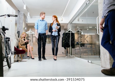 Business people in motion in modern office - stock photo