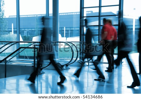 Business people in movement - stock photo
