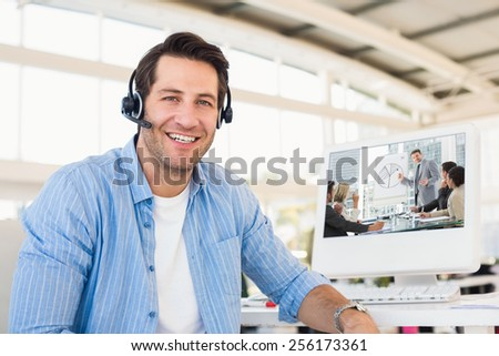 Business people in office at presentation against portrait of a smiling photo editor wearing a headset - stock photo