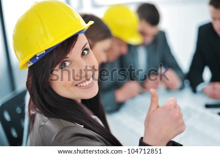 Business people in office, girl with thumbs up - stock photo