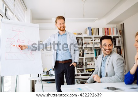 Business people in office holding a conference and discussing strategies - stock photo