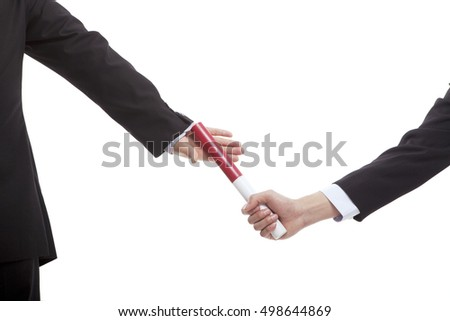 Business people in passing the baton
