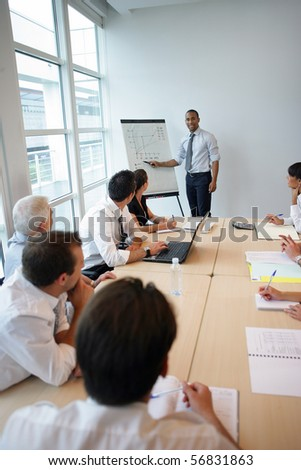 Business people in suit in a meeting room - stock photo