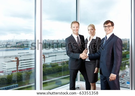 Business people in the background of a large window - stock photo