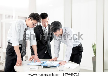 business people in the office to discuss - stock photo