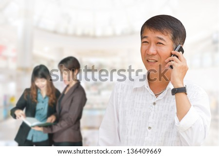 Business people in the studio, cheerful and motivated on the background of business people - stock photo