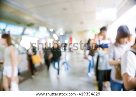 Business people in train abstract blurred background transport - stock photo