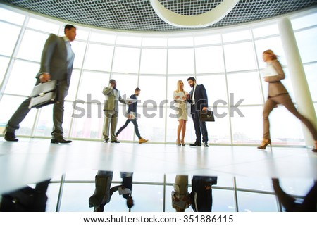 Business people interacting in modern office - stock photo