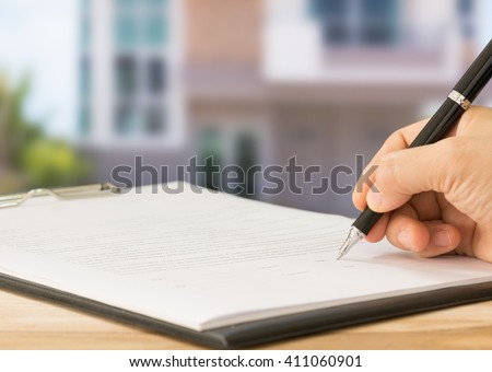 Business people is signing a contract, business contract details. Concept of housing purchase and insurance. - stock photo