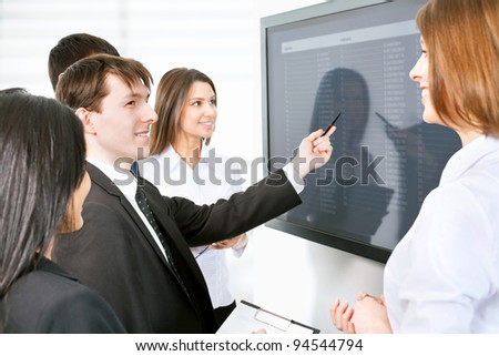 Business people is working together with the screen - stock photo