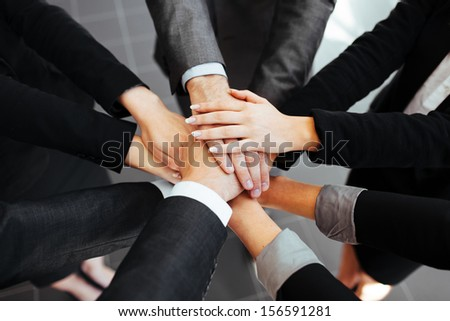 Business people joining hands. Team work concept.