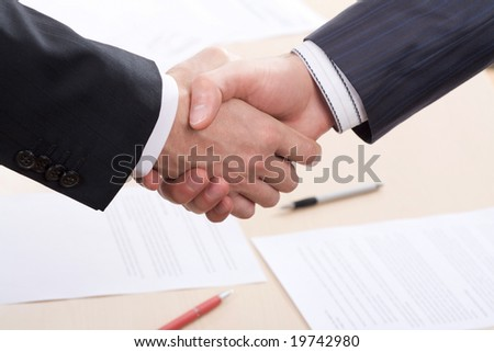 Business people joining hands together for deal - stock photo