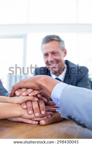 Business people joining hands together in the office - stock photo
