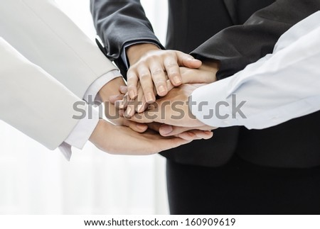 Business people joining their hands in agreement - stock photo