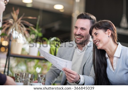 business people laugh and relax on a break in a cafe - stock photo