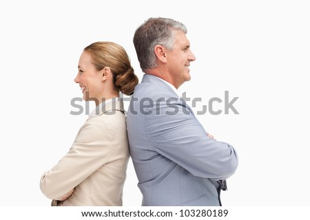 Business people laughing back to back against white background