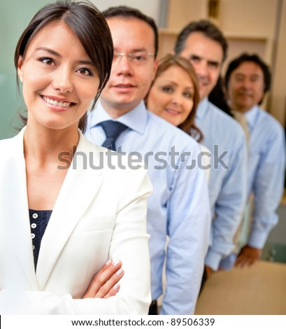 Business people lead by a female at the office - stock photo