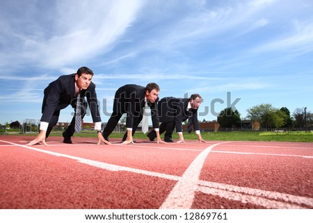 Business people lined up for race - stock photo