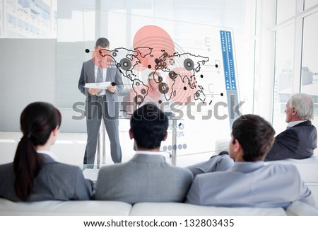 Business people listening and looking at map diagram interface in a meeting - stock photo