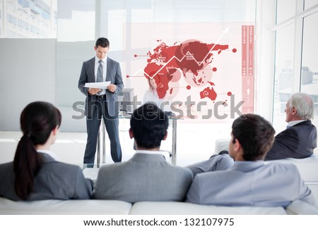 Business people listening and looking at red map diagram interface in a meeting - stock photo