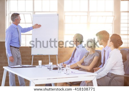 Business people listening during meeting against inside a building - stock photo