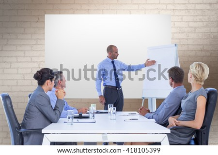 Business people listening during meeting against white wall - stock photo