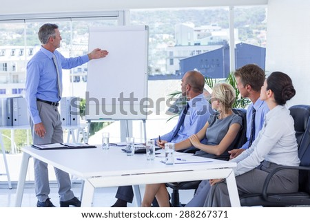 Business people listening during meeting in office - stock photo