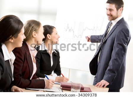 Business people listening their boss at seminar