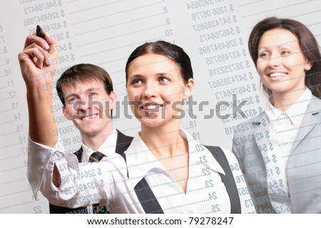 Business people look on a report in the glass board in an office