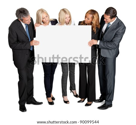 Business people looking at blank board in their hands on white background - stock photo
