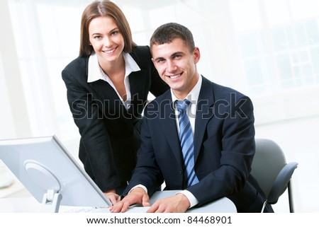 Business people looking at camera - stock photo
