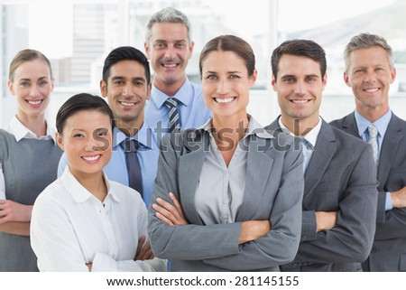 Business people looking at camera with arms crossed in office