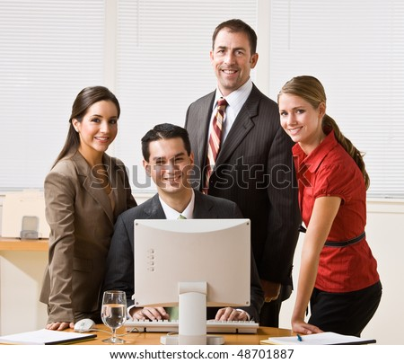 Business people looking at computer - stock photo