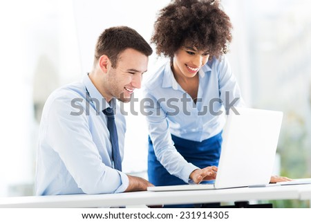 Business people looking at laptop  - stock photo