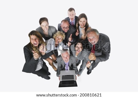 Business people looking at laptop against white background elevated view