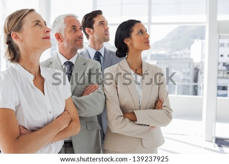 Business people looking at the same way in the workplace - stock photo