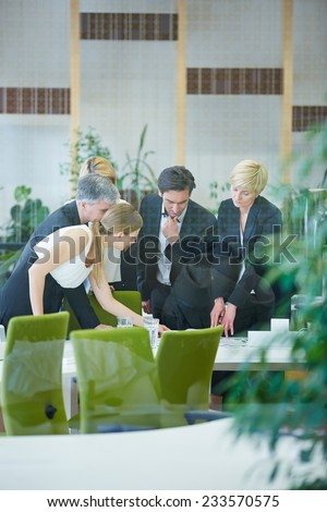 Business people making decision while in a meeting in the office - stock photo