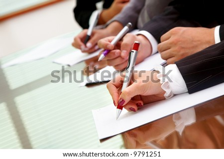 business people making notes during an office meeting - stock photo