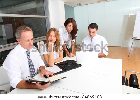 Business people meeting around table