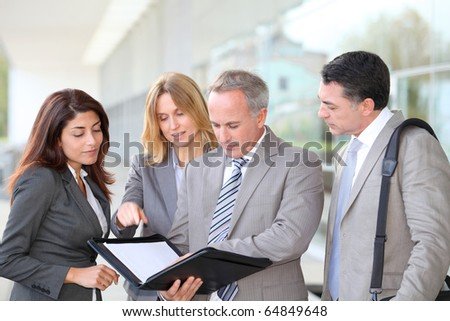 Business people meeting at an exhibition - stock photo