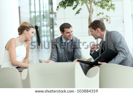 Business people meeting in airport lounge