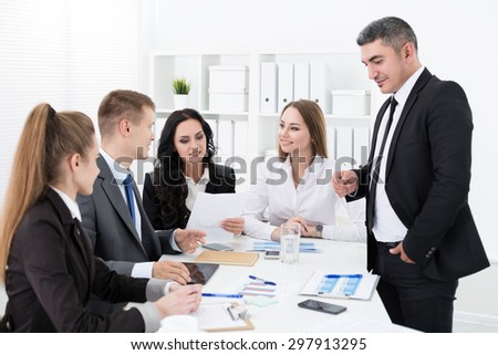 Business people meeting in office to discuss project - stock photo